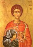 Άγιος Τρύφων ο Μάρτυρας - Ταπεινός αγρότης και ηρωικός μεγαλομάρτυρας, ο άγιος Τρύφων κρατάει το σταυρό (σύμβολο της αυτοθυσίας του) και το κλαδευτήρι, το εργαλείο της δουλειάς του, την οποία ευλογεί με τις ουράνιες προσευχές του