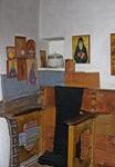 Ο σκάμνος όπου συνήθιζε να προσεύχεται ο Όσιος Παΐσιος ο Αγιορείτης (οι εικόνες που έχουν τοποθετηθεί στα αριστερά του σκάμνου είναι των Αγίων που εμφανίστηκαν στον Όσιο Παΐσιο τον Αγιορείτη)