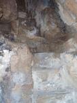 Οι σχεδόν κάθετες<br />λαξευμένες βαθμίδες<br />εξόδου οροφής<br />σπηλαίου αγιάσματος<br />Παναγίας Αργοκοιλιώτισσας