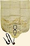 Πατριαρχικό και συνοδικό σιγίλλιο του Kυρίλλου A' Λουκάρεως (Στο κάτω μέρος, με γαλάζια μήρινθο απαιωρείται μολύβδινη σφραγίδα του πατριάρχη Kυρίλλου Λουκάρεως)- Δεκέμβριος 1633 μ.Χ. - Mονή Iβήρων, Άγιον Όρος